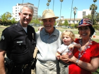 Senior Lead Officer Phillip Enbody, Ray Keller, Marylin Krell with grandson Asher Madnick Photo by Dick Thompson